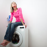 Housework: young woman doing laundry. (shallow DOF; color toned image Royalty Free Stock Photo