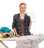 Housework - young woman ironing clothes Stock Photos