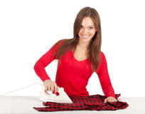 Housework - young woman ironing clothes Royalty Free Stock Image