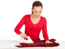 Housework - young woman ironing clothes Royalty Free Stock Images