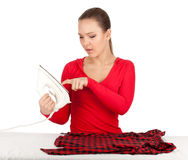 Housework - young woman ironing clothes Royalty Free Stock Photography