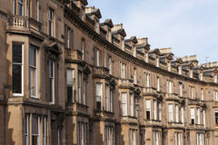 Housing. Traditional Gregorian flats in a row, shaped in a bow form stock images