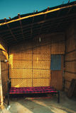 Housing with a bed in the slums of India. Dilapidated housing with a bed in the slums of India Royalty Free Stock Photography