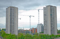 Housing block repair. Buildings being restored or repaired, with cranes at the side Stock Photo