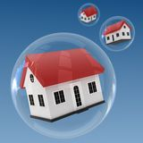 Housing Bubble. 3 Houses inflated in bubbles Royalty Free Stock Images