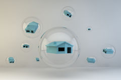 Housing Bubble. A series of houses contained within bubbles set against a white background Stock Image