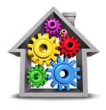 Housing Business. And home economics represented by a house icon with gears and cogs inside the home as real estate symbols of  the  residential construction Stock Photos