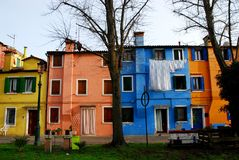 Housing colorful and white sheets to dry in Burano in the municipality of Venice in Italy. Photo made in the island of Burano in Venice in Italy. In the image Stock Images