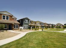 Housing community. A row of new houses in a green environment friendly commuinty Royalty Free Stock Image
