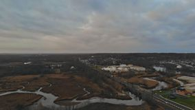 Housing community development aerial view of residential houses and driveways neighborhood during a fall sunset. Housing community development aerial view of US stock video footage