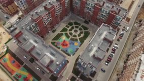 Housing complex with new and unfinished apartment blocks, Russia. Aerial shot of residential compound and inner court with following view to housing complex with stock video footage
