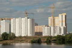 Housing construction in Moscow region. Russia. Moscow region. Krasnogorsk town. Large-scale housing construction in the floodplain Pavshinskaja the Moscow River Royalty Free Stock Photography