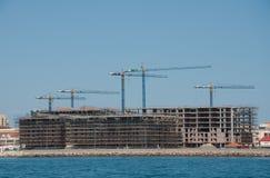 Housing construction. A new sea front concrete apartment block under construction stock images