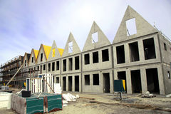 Housing construction site. Building of a row concrete skeletons of new houses Royalty Free Stock Photography