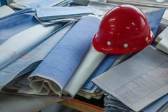 Housing construction site site office construction drawings on the helmets Stock Images