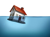 Housing Crisis. Sinking home and housing crisis with a house in the water on a white background showing the real estate housing concept of the challenges of home Royalty Free Stock Photography