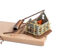 Housing crisis. Model house of a shell in a mousetrap. symbolic photo for debt and housing crisis Royalty Free Stock Image