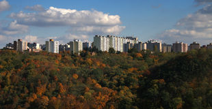 Housing development. Large housing development, autumn trees in the foreground Stock Photo