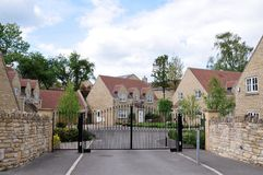 Housing Development. Gated Entrance of a New Housing Development of Detached Stone Homes Royalty Free Stock Photos