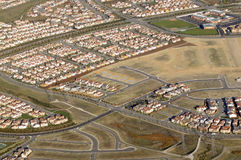 Housing development from the air. Modern Housing development with unfinished lots from the air Royalty Free Stock Photography