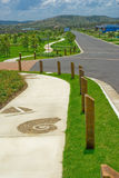 Housing Development Pathways. Beautiful lush green walkways of a new development area. The real estate is ready for new homes to be built, with lawns and gardens royalty free stock image
