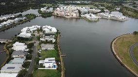 Housing estate emerald lakes gold coast overlooking large shopping center stock video