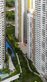 Housing Estate. High angle view of a colorful neighborhood estate with swimming pool and carpark Stock Images