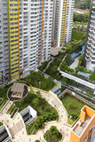 Housing Estate. High angle view of a colorful neighborhood estate with swimming pool and roof garden Royalty Free Stock Photo