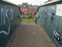 Housing estate. Viewed from a railway bridge with graffiti Royalty Free Stock Photo