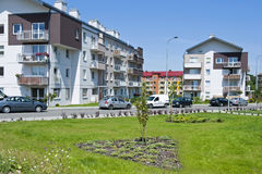Housing estates. Housing estate with green lawn and blue sky. Housing development Stock Images