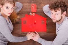 Couple on floor with symbols. Stock Photography