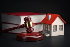Housing legislation concept - law books, house and gavel