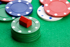 Housing Market Gabmle. Casino chips with toy house - housing market gamble concept Royalty Free Stock Photography