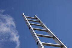 Housing market property ladder. Bright silver ladder against a blue sky Royalty Free Stock Photography