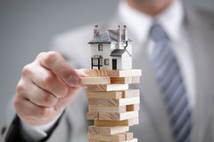 Housing market risk. Investment risk and uncertainty in the real estate housing market Stock Images