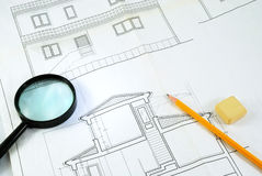 Housing plane and magnifying glass Stock Photos