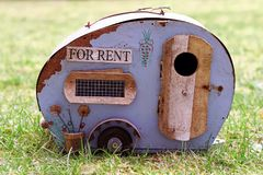 Symbolic for an old broken caravan and a bad accommodation. Housing for rent. Holidays with the caravan. Symbolic for an old broken caravan and a bad royalty free stock images