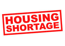 HOUSING SHORTAGE. Red Rubber Stamp over a white background Royalty Free Stock Photo