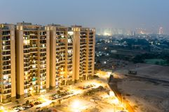 Housing skyscrapers in gurgaon at dusk with skyline. Housing sociery skyscrapers and buildings in gurgaon shot at dusk with the city skyline visible. The arid stock photography
