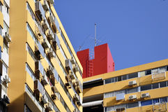 Building soars into blue sky Royalty Free Stock Images