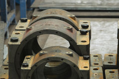 Housings for industrial bearings. Heavy duty steel housings for industrial bearings at a production workshop royalty free stock image