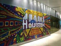Houston Airport graffiti. Welcoming graffiti in Houston Airport Stock Photo