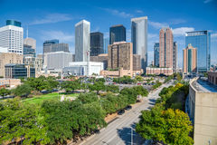 Houston downtown. Aerial day view of Houston downtown skylines with green park trees and skyscrapers background in blue cloud sky. Houston is the most populous Stock Photo