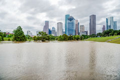 Houston Downtown Flood. Downtown Houston at daytime with storm cloud sky and rare high water flood on Eleanor Park because of Harvey Tropical Storm. Heavy rains royalty free stock photos