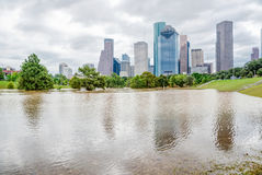 Houston Downtown Flood. Downtown Houston at daytime with storm cloud sky and rare high water flood on Eleanor Park because of Harvey Tropical Storm. Heavy rains royalty free stock photography