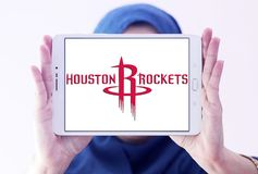 Houston Rockets american basketball team logo. Logo of Houston Rockets team on samsung tablet holded by arab muslim woman. The Houston Rockets are an American Royalty Free Stock Images