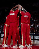 Houston Rockets. The 1990's Houston Rockets meet at the free throw circle after introductions.  Otis Thorpe, Hakeem Olajuwon, Kenny Smith. (Image taken from Stock Photography