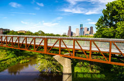 Houston Skyline. City of Houston Texas skyline photographed from the west side on Memorial Drive.  Pedestrian walk bridge over buffalo bayou Stock Photo