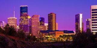 Houston skyline during sunset with illuminated skyscrapers royalty free stock photography