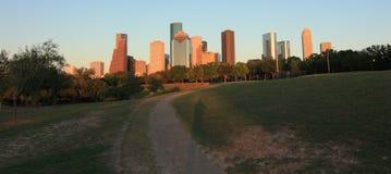 Houston skyline at sunset. HOUSTON, TEXAS - JULY 31, 2014: Houston, Texas skyline at sunset twilight from park lawn stock photo
